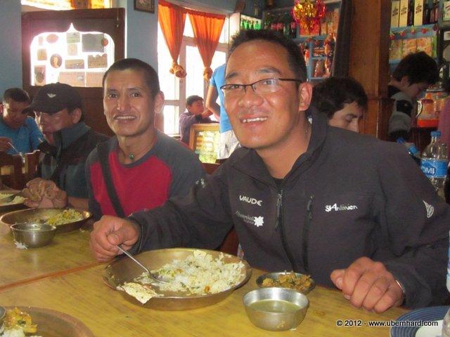 Pasang Karma Sherpa and Ang Pasang Sherpa enjoying their last Nepali food for a while.<br />